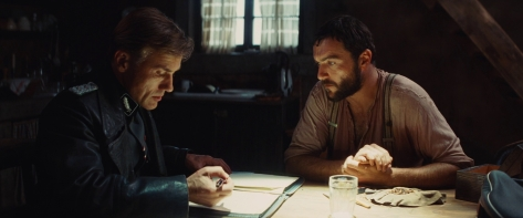 Hans_Landa_and_LaPadite_look_in_the_notebook